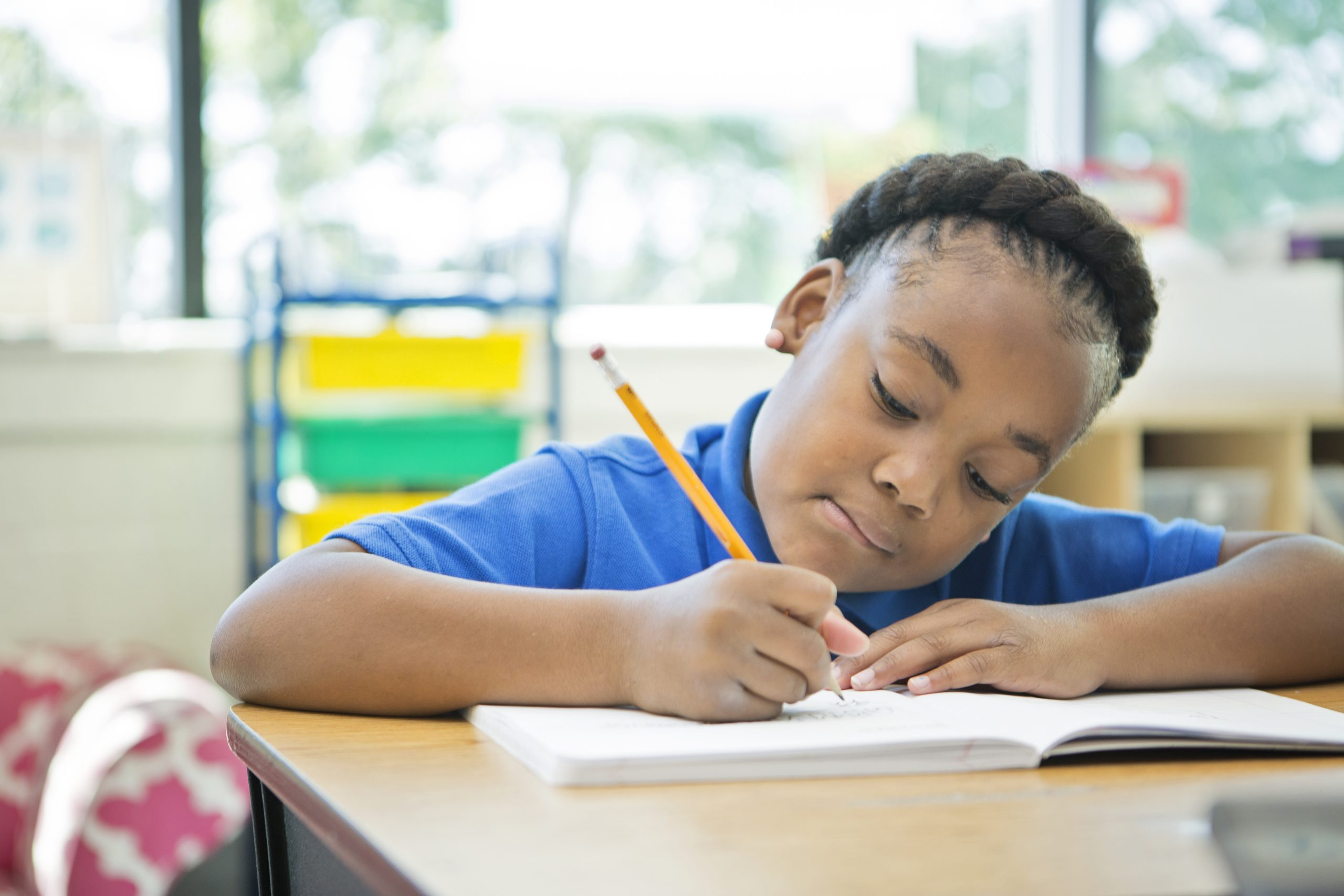 photo of child in school writing in a workbook